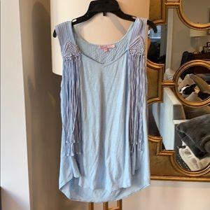 Calypso light-blue fringe top.